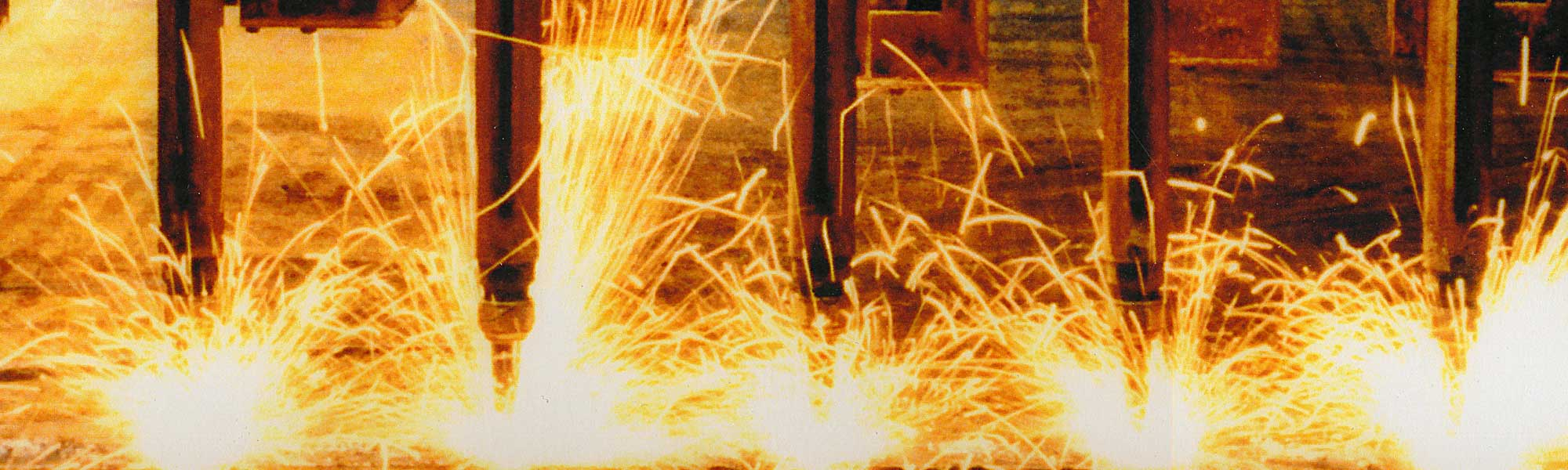 sparks flying at a steel fabrication shop