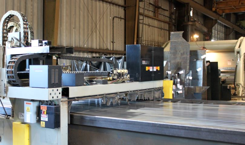 steel fabrication warehouse with robot cutting with a waterjet