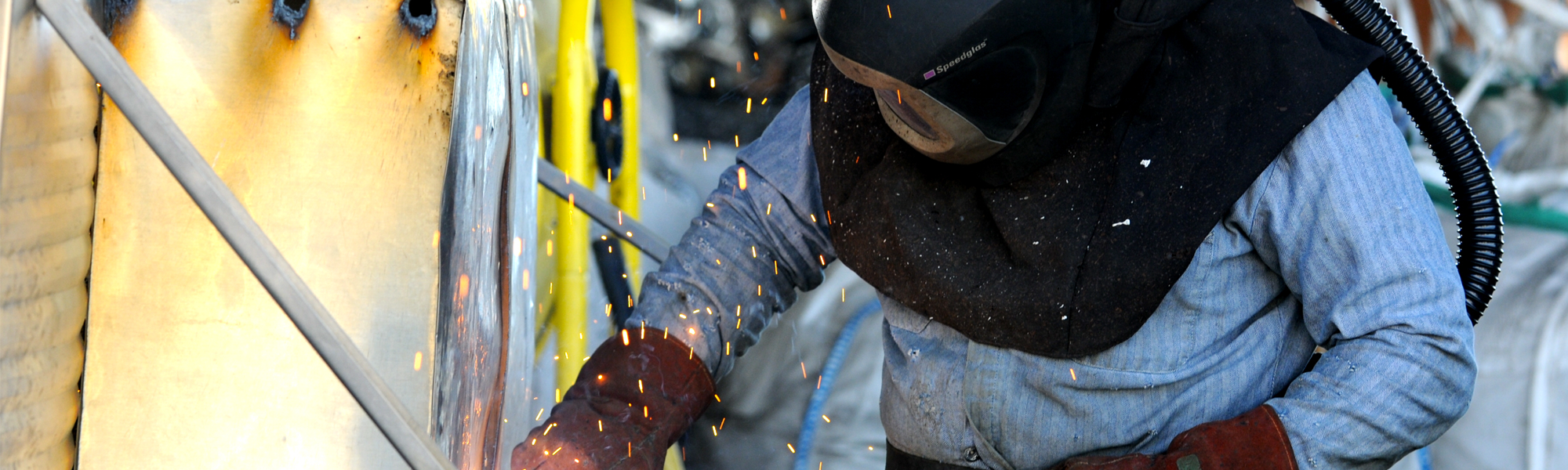 welder working on scrap metal