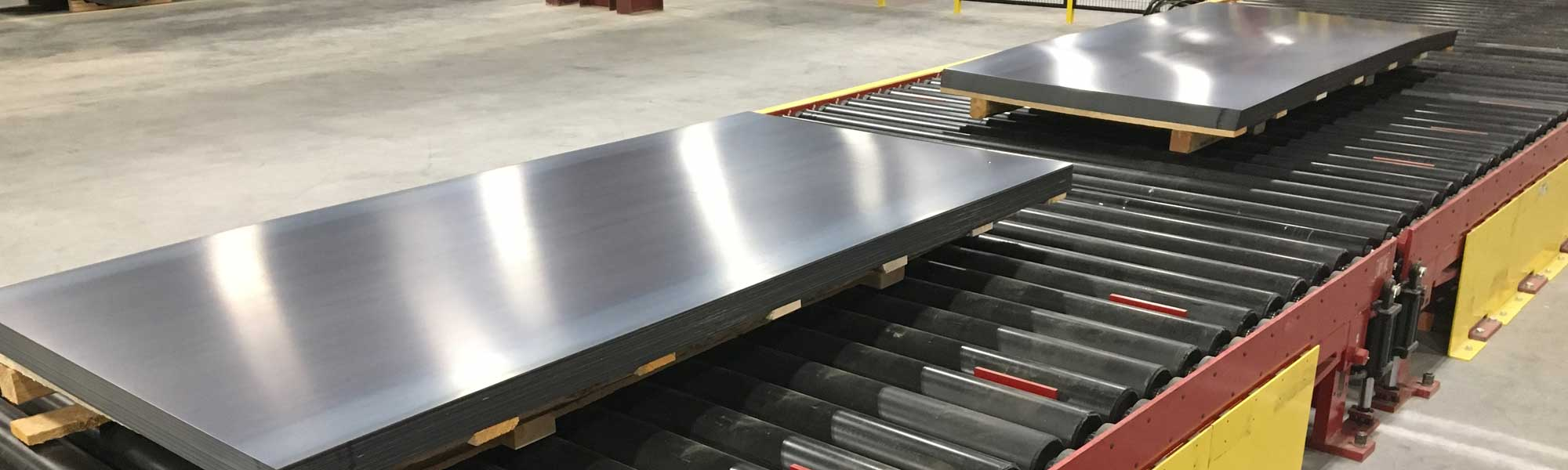 large steel plates at distribution center
