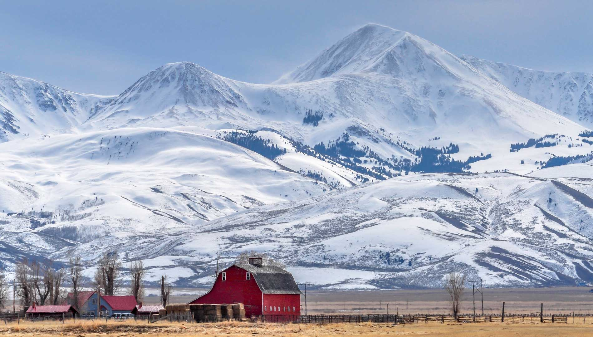 Winter photo of house and mountain in Great Falls Montana