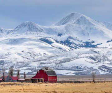 Photo of farm in front of mountains in Montana