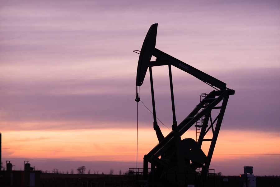 Oil drill in North Dakota at sunset