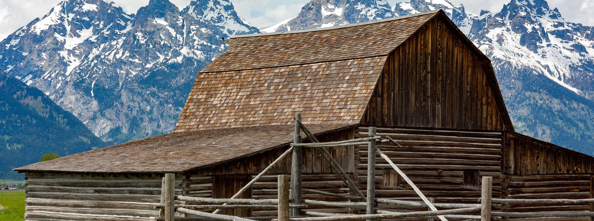 barn with mountains in the background